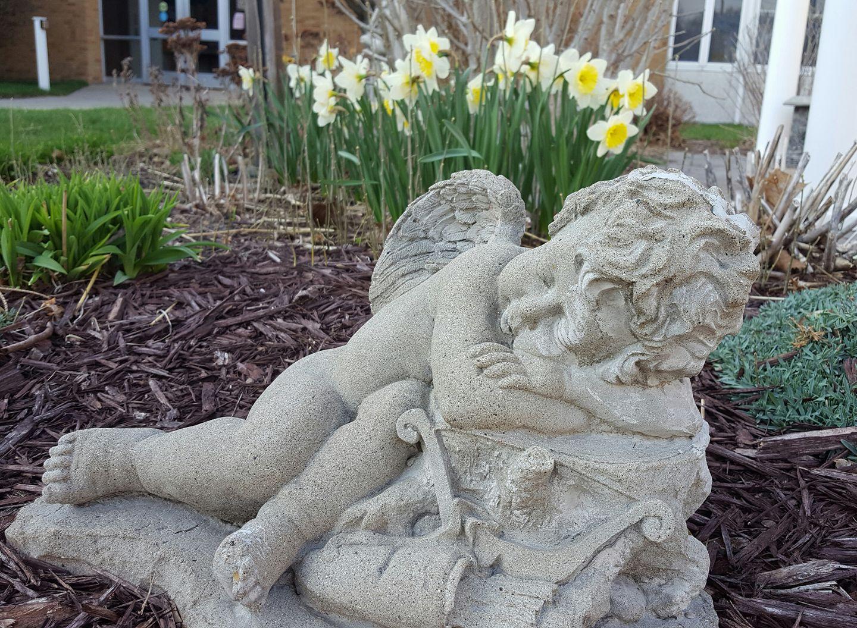 sleeping cherub statue in garden