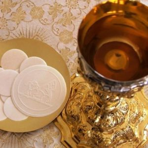 Communion wafers and cup of wine for the Eucharist celebration.