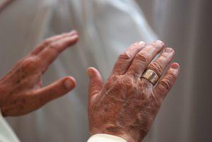Priest extending his hands in prayer.